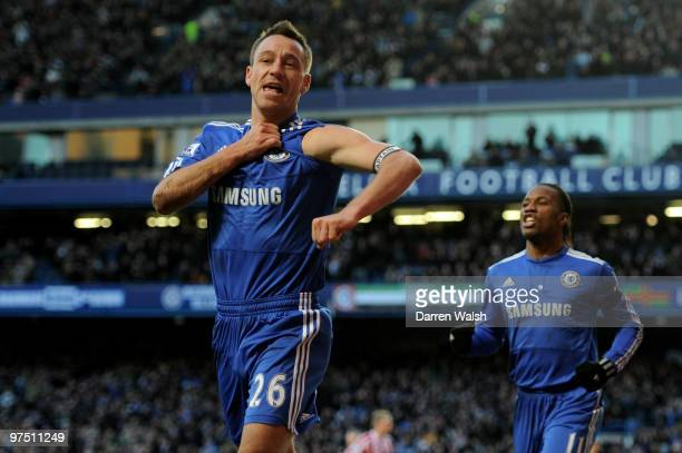 John Terry the Chelsea captain celebrates after scoring his team's second goal during the FA Cup sponsored by E.on quarter final match between...