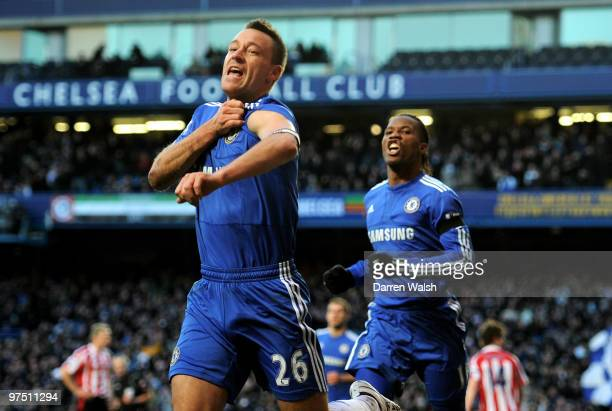 John Terry the Chelsea captain celebrates with teammate Didier Drogba after scoring his team's second goal during the FA Cup sponsored by Eon quarter...