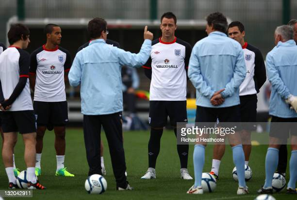 John Terry watches on as Fabio Capello gives his team talk during the England training session at London Colney on November 10 2011 in St Albans...