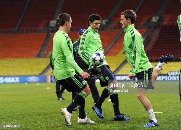John Terry Yury Zhirkov Josh McEachran of Chelsea during the Chelsea training session ahead of the UEFA Champions League Group F match against...