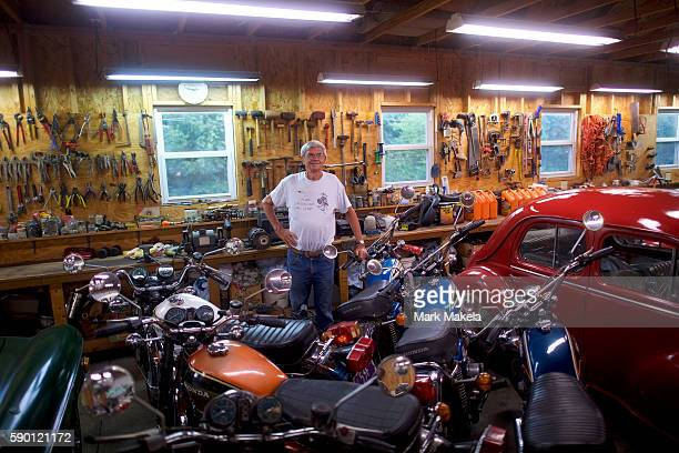 John Theisen a Donald Trump supporter poses in front of his antique collection of motorcycles and cars on August 14 2016 in New Ringgold Pennsylvania...