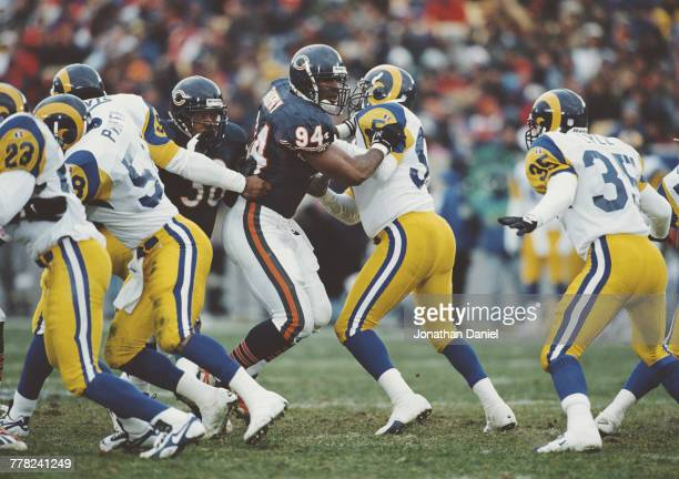 John Thierry Defensive End for the Chicago Bears blocks Robert Jones of the Los Angeles Ramsduring the National Football Conference Central game...