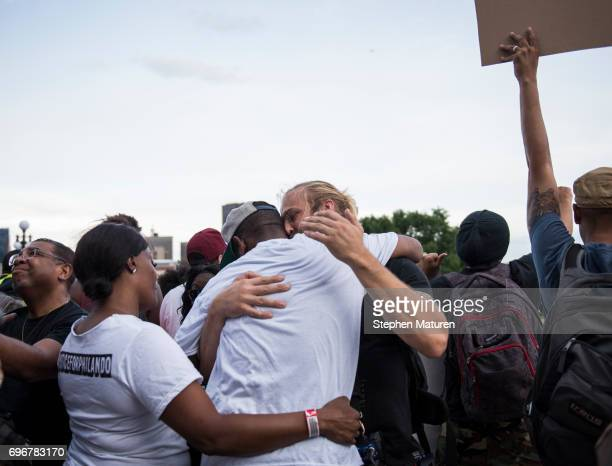 John Thompson a friend and former colleague of Philando Castile is embraced after speaking on the steps of the Minnesota State Capitol building on...
