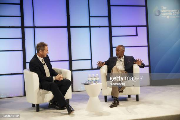 John Thompson chief executive officer of Virtual Instruments Corp and chairman of Microsoft Corp right speaks as Aled Miles chief executive officer...