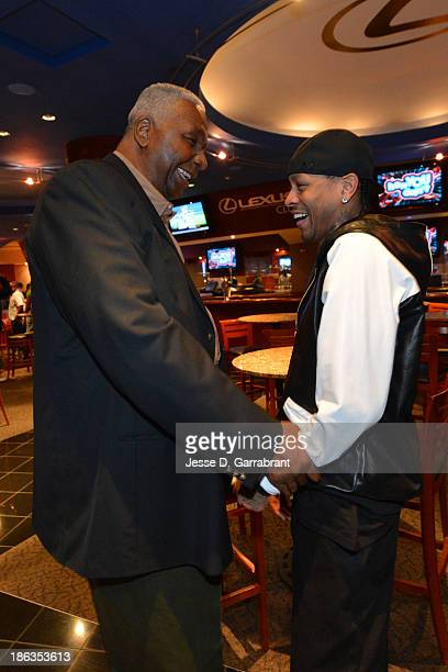 John Thompson former Georgetown coach and former NBA player Allen Iverson pose for a picture during his retirement press conference at the Wells...