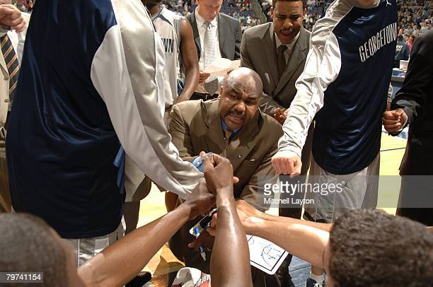 John Thompson III head coach of the Georgetown Hoyas talks to team during a timeout of a basketball game against the South Florida Bulls at Verizon...