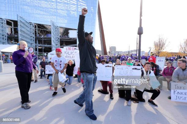John Thompson leads demonstrators in a protest of police violence before the game between the Baltimore Ravens and Minnesota Vikings on October 22...