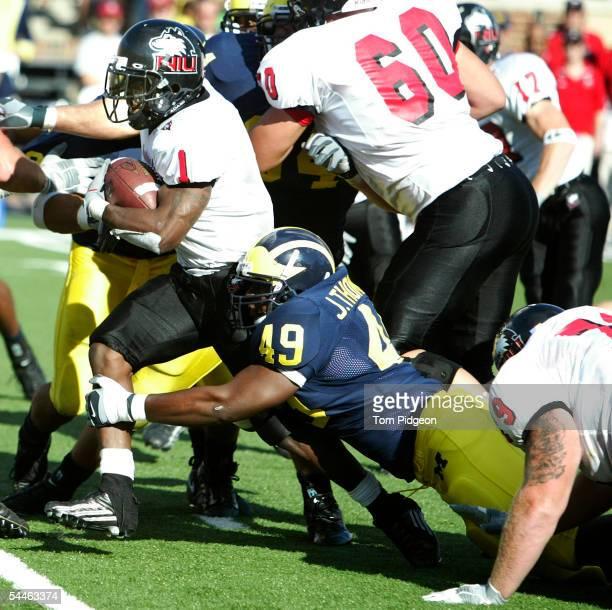 John Thompson of Michigan tackles Garrett Wolfe of Northern Illinois at Michigan Stadium on September 3 2005 in Ann Arbor Michigan Michigan won the...