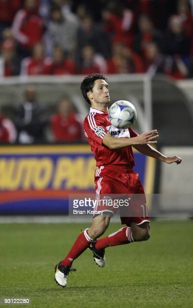 John Thorrington of the Chicago Fire handles the ball against Real Salt Lake during overtime of the MLS Eastern Conference Championship at Toyota...