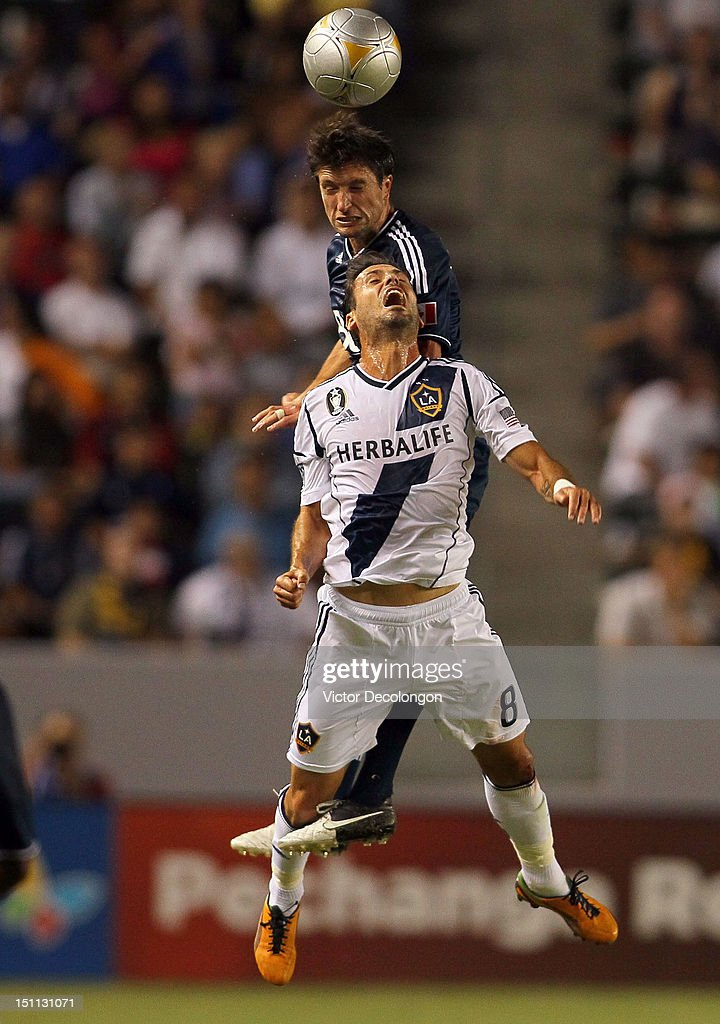 John Thorrington #11 of the Vancouver Whitecaps wins a header over Marcelo Sarvas #8 of the Los Angeles Galaxy in the first half during the MLS match at The Home Depot Center on September 1, 2012 in Carson, California. The Galaxy defeated the Whitecaps 2-0.