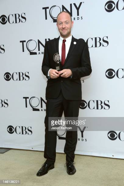 John Tiffany poses in the 66th Annual Tony Awards press room at The Beacon Theatre on June 10 2012 in New York City