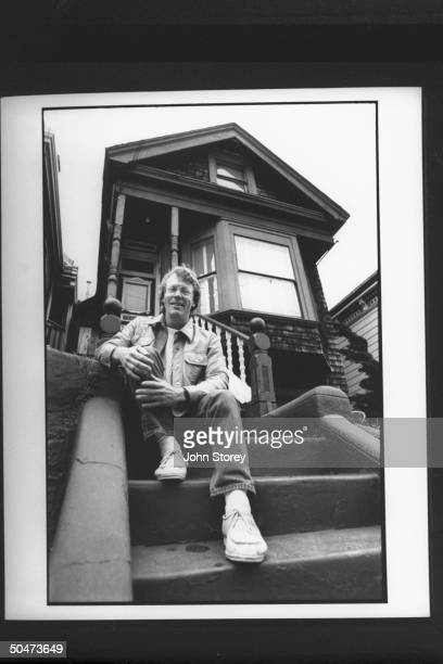 John Timothy exlover of New Age nondenominational min Marianne Williamson sitting on front steps of 2story house on Castro St which they shared in...