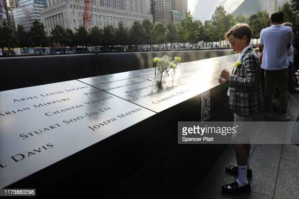 John Timson pauses at the National September 11 Memorial where his uncle Andrew Fisher's name is etched into a panel with other victims during a...