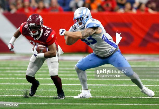 John Timu of Salt Lake Stallions chases Trey Williams of San Antonio Commanders during the first quarter of their Alliance of American Football game...