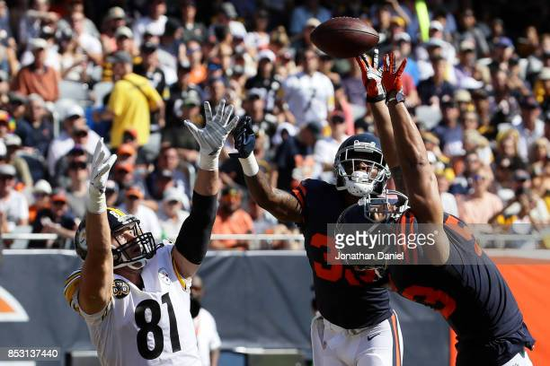 John Timu of the Chicago Bears attempts to make the catch against Jesse James of the Pittsburgh Steelers in the third quarter at Soldier Field on...