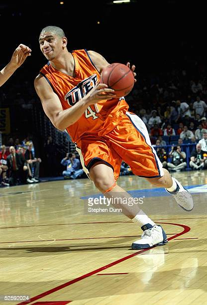 John Tofi of the UTEP Miners moves the ball during the game with the Utah Utes in the first round of the NCAA Men's Basketball Championship on March...