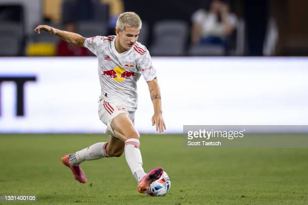 John Tolkin of New York Red Bulls kicks the ball against D.C. United during the second half of the MLS game at Audi Field on July 25, 2021 in...