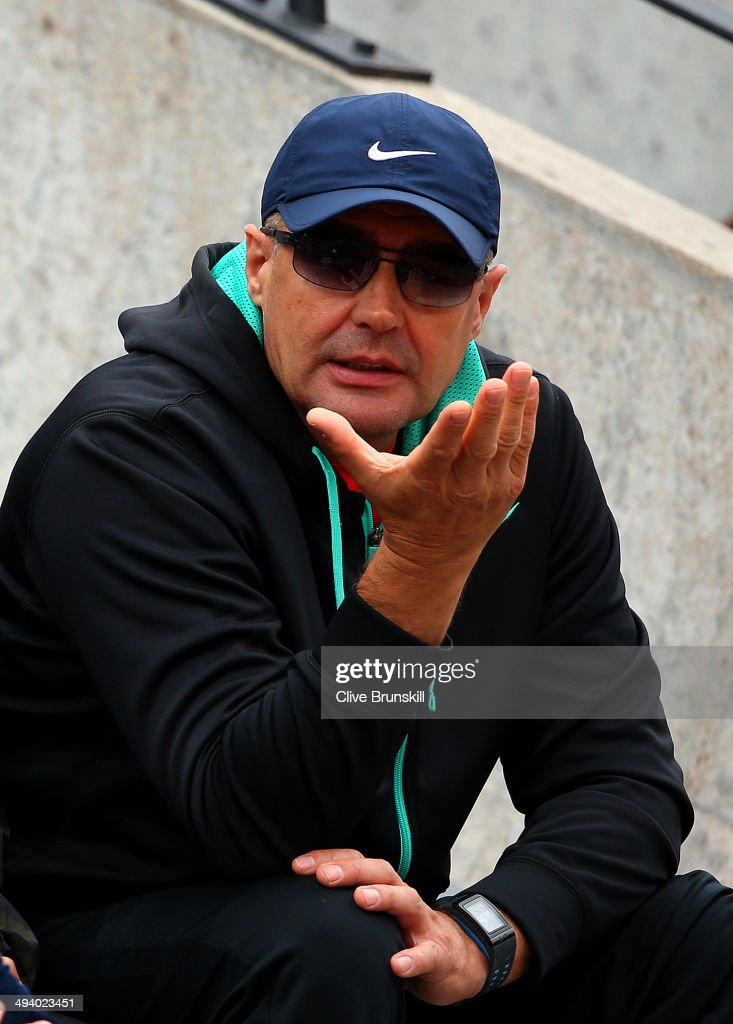 John tomic, the father of Bernard Tomic of Australia reacts as he watches his son's men's singles match against Richard Gasquet of France on day three of the French Open at Roland Garros on May 27, 2014 in Paris, France.