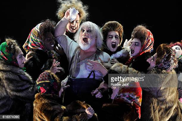 John Tomlinson as Ivan Iakovlevitch with artists of the company in Dmitry Shostakovich's The Nose directed by Barrie Kosky and conducted by Ingo...