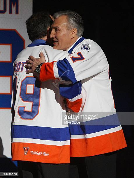 John Tonelli and Bryan Trottier of 'The 'Core of the Four' New York Islanders Stanley Cup championships take part in a ceremony prior to the...