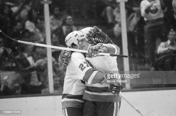 John Tonelli and teammate of the New York Islanders celebrate after Tonelli scored a goal against the Toronto Maple Leafs on January 6 1981 at Nassau...