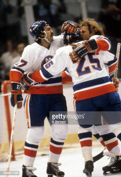 John Tonelli Bob Nystrom and Dave Lewis of the New York Islanders celebrate a goal against the Atlanta Flames on October 16 1979 at the Nassau...