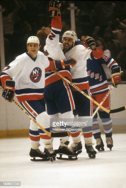 John Tonelli Bob Nystrom and Stefan Persson of the New York Islanders celebrate after scoring a goal against the New York Rangers circa 1980 at the...
