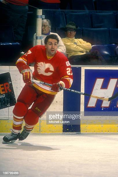 John Tonelli of the Calgary Flames looks on during a hockey game against the Washington Capitals on March 3 1989 at the Capital Centre in Landover MD...