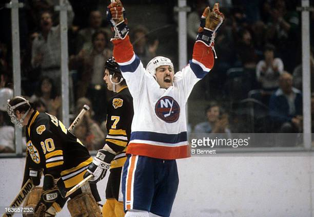 John Tonelli of the New York Islanders celebrates on the ice during the 1980 Quarter Finals against the Boston Bruins in April, 1980 at the Nassau...