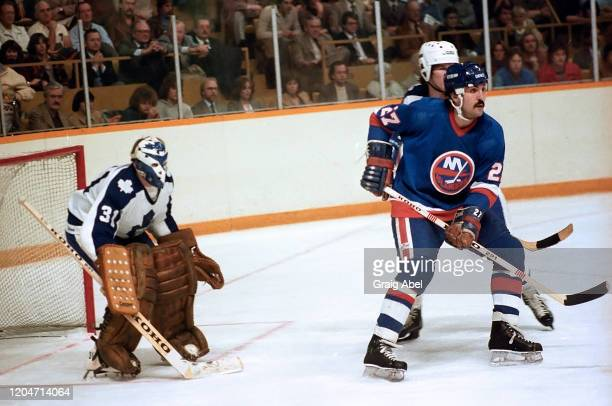 John Tonelli of the New York Islanders skates against Jiri Crha the Toronto Maple Leafs during NHL game action on November 12 1980 at Maple Leaf...