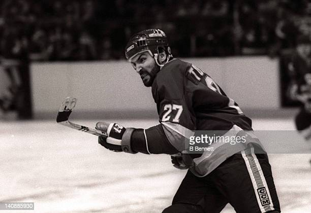 John Tonelli of the New York Islanders skates on the ice during Game 3 of the 1982 Division Finals against the New York Rangers on April 18 1982 at...