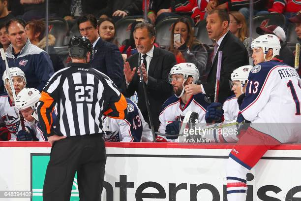 John Tortorella Head Coach of the Columbus Blue Jackets looks on from behind the bench during the game against the New Jersey Devils at Prudential...