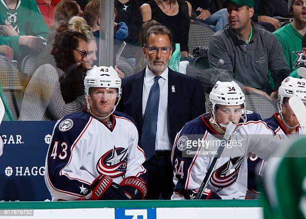 John Tortorella head coach of the Columbus Blue Jackets watches the action from the bench against the Dallas Stars at the American Airlines Center on...