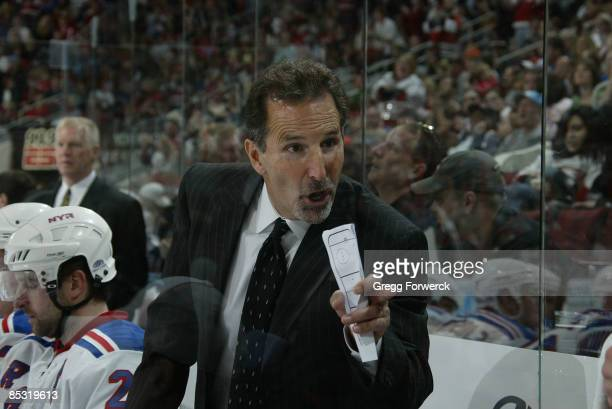 John Tortorella head coach of the New York Rangers coaches strategy during a NHL game against the Carolina Hurricanes on March 9 2009 at RBC Center...