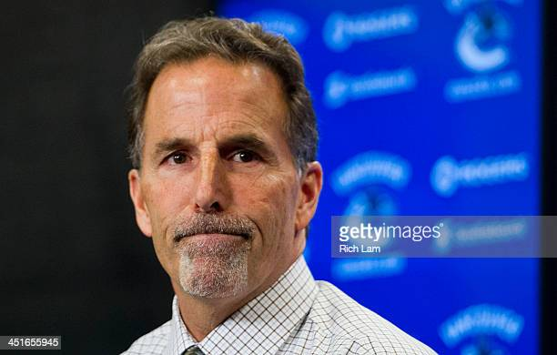 John Tortorella Head Coach of the Vancouver Canucks reacts after answering a quesiton during the post game press conference after NHL action between...
