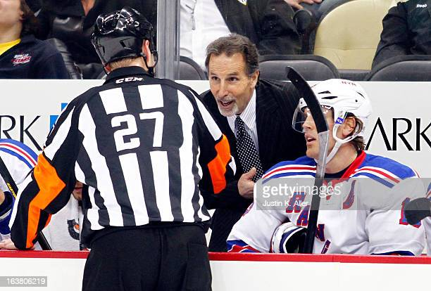 John Tortorella of the New York Rangers talks with referee Eric Furlatt during the game against the Pittsburgh Penguins at Consol Energy Center on...