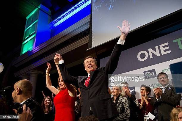 John Tory mayorelect of Toronto center and his wife Barbara Hackett wave to the crowd after Tory delivered his victory speech at an election night...