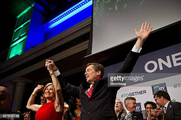John Tory mayorelect of Toronto right and his wife Barbara Hackett wave to the crowd after Tory delivered his victory speech at an election night...