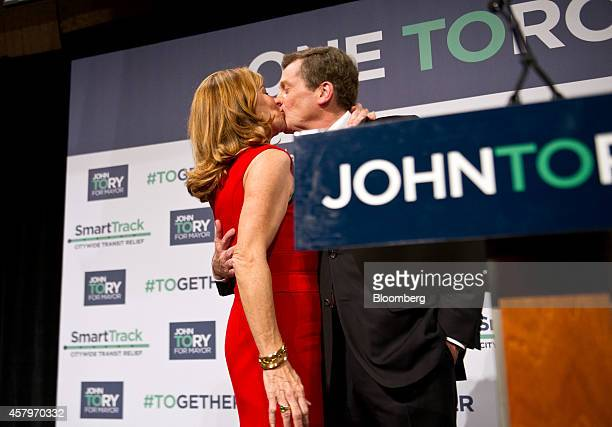 John Tory mayorelect of Toronto right kisses his wife Barbara Hackett after delivering his victory speech at an election night party in Toronto...