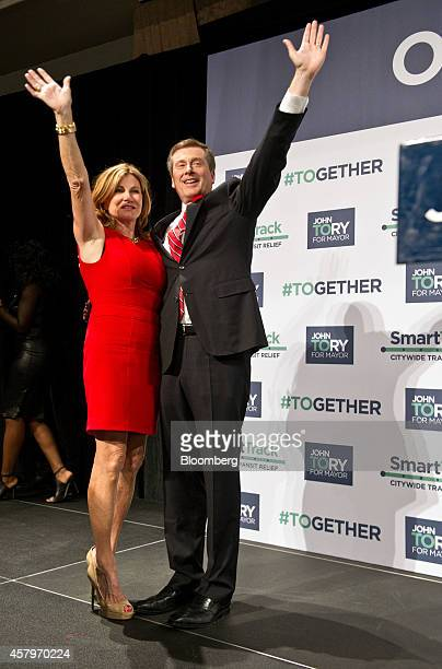 John Tory mayorelect of Toronto right waves to the crowd alongside his wife Barbara Hackett before delivering his victory speech at an election night...