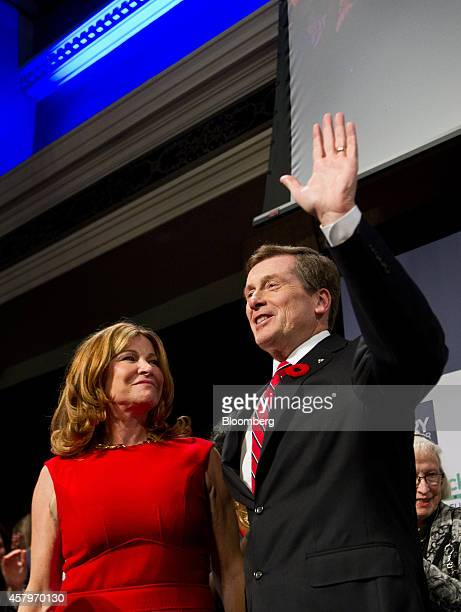 John Tory mayorelect of Toronto right waves to the crowd as his wife Barbara Hackett looks on after Tory delivered his victory speech at an election...