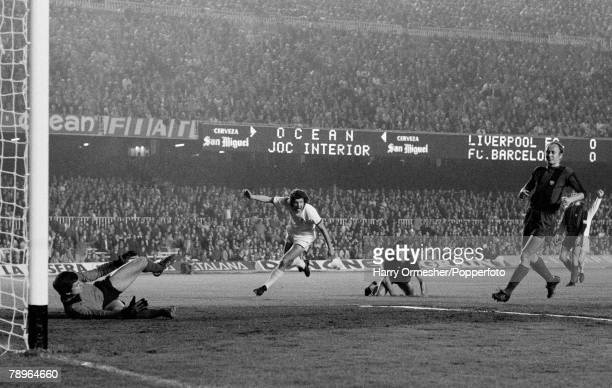John Toshack of Liverpool celebrates after scoring past Barcelona goalkeeper Pere Valenti Mora during the UEFA Cup Semi Final 1st Leg between...