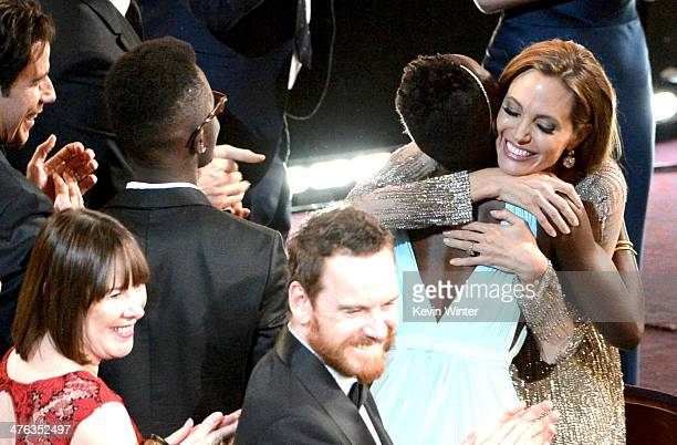 John Travolta Adele Fassbender Peter Nyong'o Jr Michael Fassbender Lupita Nyong'o and Angelina Jolie celebrate as 12 Years A Slave is awarded Best...