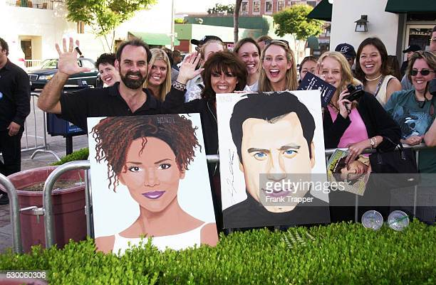 John Travolta and Halle Berry fans display their enthusiam at the premiere of Swordfish