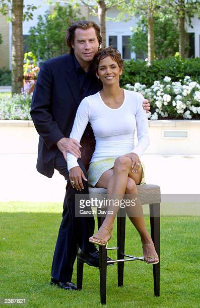 John Travolta and Halle Berry sit for a photo to promote their new movie Swordfish at the Four Seasons Hotel Canary wharf London 25/6/01 Photo by...
