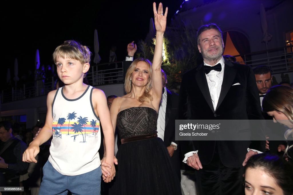 John Travolta and his son Benjamin Travolta(L) and hiw wife Kelly Preston (C) during the party in Honour of John Travolta's receipt of the Inaugural Variety Cinema Icon Award during the 71st annual Cannes Film Festival at Hotel du Cap-Eden-Roc on May 15, 2018 in Cap d'Antibes, France.