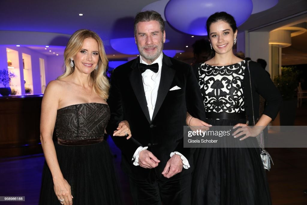 John Travolta and his wife Kelly Preston (L) and daughter Ella Bleu Travolta (R) during the party in Honour of John Travolta's receipt of the Inaugural Variety Cinema Icon Award during the 71st annual Cannes Film Festival at Hotel du Cap-Eden-Roc on May 15, 2018 in Cap d'Antibes, France.