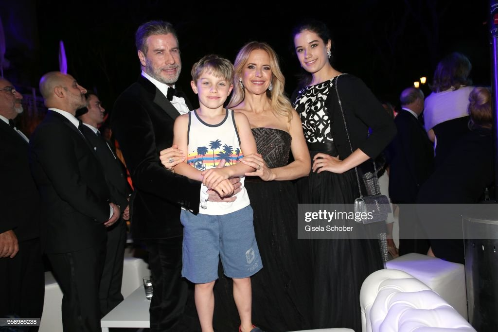 John Travolta and his wife Kelly Preston, daughter Ella Blue Travolta (R) and son Benjamin Travolta during the party in Honour of John Travolta's receipt of the Inaugural Variety Cinema Icon Award during the 71st annual Cannes Film Festival at Hotel du Cap-Eden-Roc on May 15, 2018 in Cap d'Antibes, France.