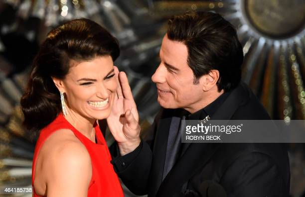 John Travolta and Idina Menzel present an award on stage at the 87th Oscars February 22 2015 in Hollywood California AFP PHOTO / Robyn BECK / AFP...
