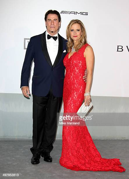 John Travolta and Kelly Preston attend amfAR's 21st Cinema Against AIDS Gala Presented By WORLDVIEW BOLD FILMS And BVLGARI at the 67th Annual Cannes...